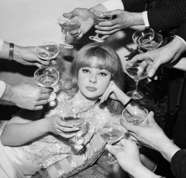 60s-woman-surrounded-by-champagne